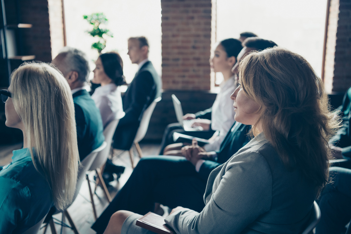 Profile side view of nice focused crowd elegant classy stylish sharks experts members participants attending educative classes courses lecture at industrial loft style interior work place station.